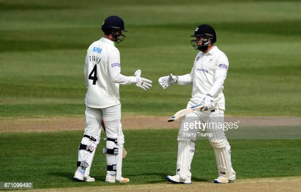 Chris Dent of Gloucestershire celebrates his half century during Day One of the Specsavers County Championship Division Two match between...