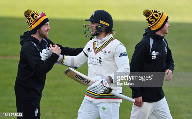 Chris Dent of Gloucestershire celebrates with his team mates after securing victory during day four of the LV= County Championship match between...