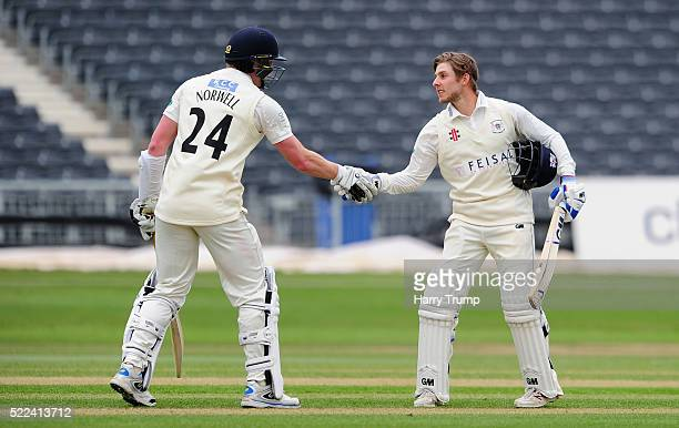 Chris Dent of Gloucestershire celebrates with Liam Norwell of Gloucestershire after reaching his century during Day Three of the Specsavers County...
