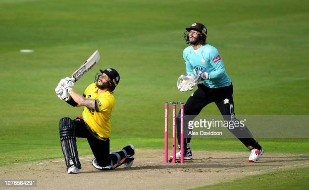 Chris Dent of Gloucestershire hits out watched on by Ben Foakes of Surrey during the Vitality Blast 2020 Semi Final match between Surrey and...
