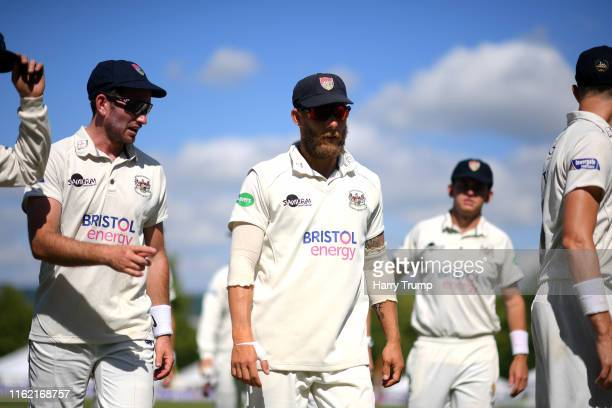Chris Dent of Gloucestershire leads his side off for tea during Day One of the Specsavers County Championship Division Two match between...