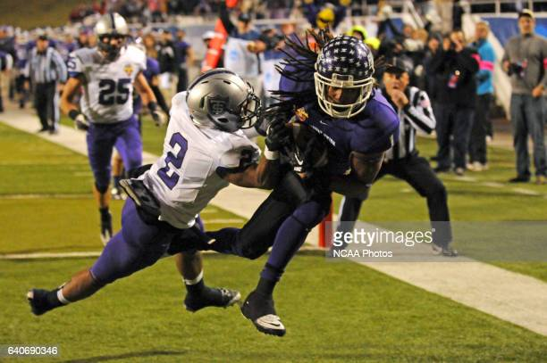 Chris Dentin of Mount Union College hauls in a touchdown pass as Chinni Oji of the University of St. Thomas defends in the second half during the...