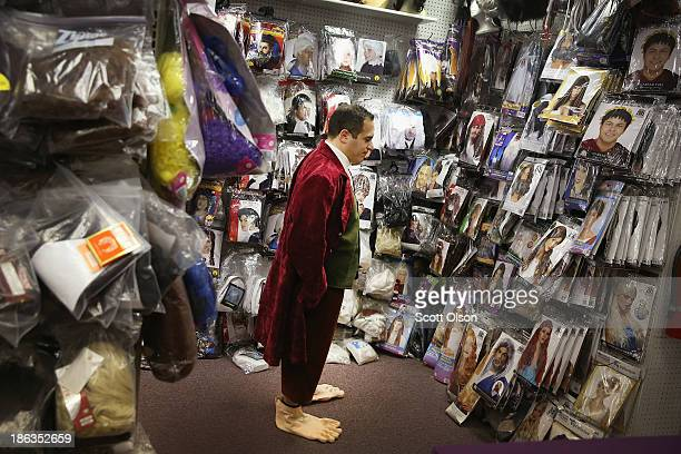Chris DeRose looks for a wig to complete his Bilbo Baggins Halloween costume at Fantasy Costumes on October 30 2013 in Chicago Illinois Although...