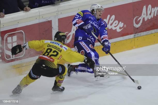 Chris DeSousa of Vienna and Christof Kromp of Villach during the Vienna Capitals v EC VSV Erste Bank Eishockey Liga at Erste Bank Arena on January 18...