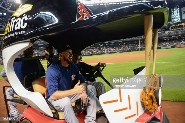 Chris Devenski Collin McHugh and Brad Peacock of the Houston Astros take a ride to the bullpen in the bullpen cart prior to the MLB game between the...