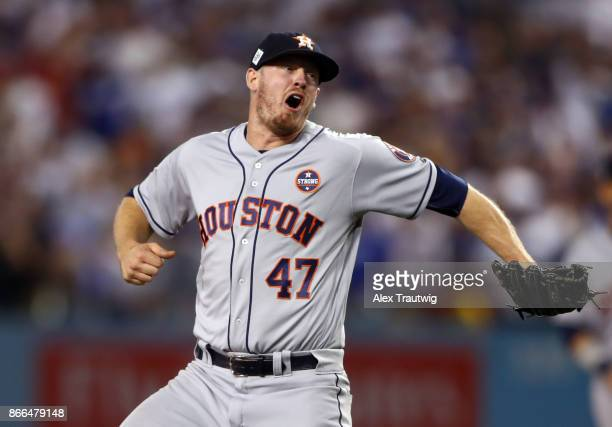Chris Devenski of the Houston Astros celebrates after the final out of Game 2 of the 2017 World Series against the Los Angeles Dodgers at Dodger...