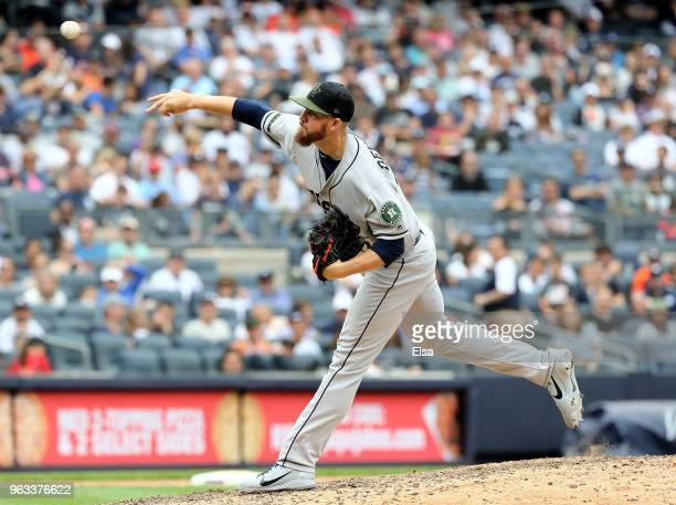 Chris Devenski of the Houston Astros delivers a pitch against the New York Yankees at Yankee Stadium on May 28 2018 in the Bronx borough of New York...