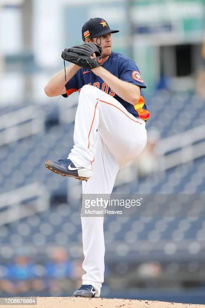 Chris Devenski of the Houston Astros delivers a pitch in the third inning against the Miami Marlins during a Grapefruit League spring training game...