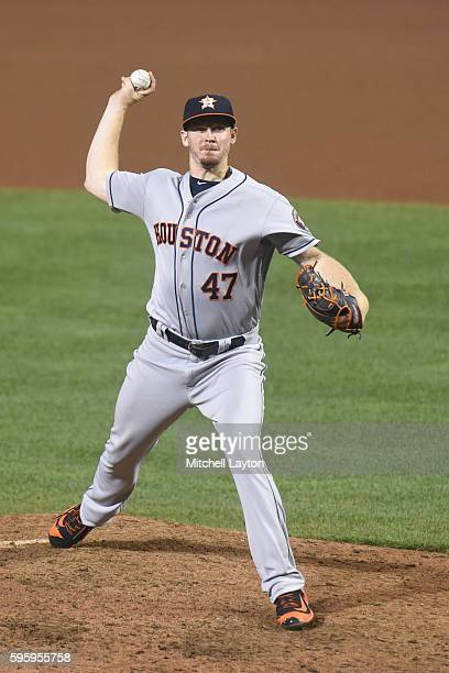 Chris Devenski of the Houston Astros pitches during a baseball game against the the Baltimore Orioles at Oriole Park at Camden Yards on August 19...