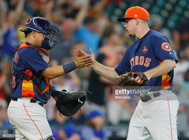 Chris Devenski of the Houston Astros shakes hands with Juan Centeno after the final out as they defeated the New York Mets 86 at Minute Maid Park on...