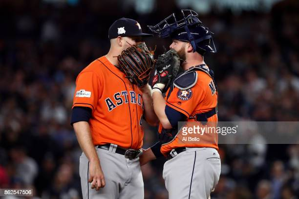 Chris Devenski of the Houston Astros speaks to Brian McCann during the seventh inning against the New York Yankees in Game Four of the American...