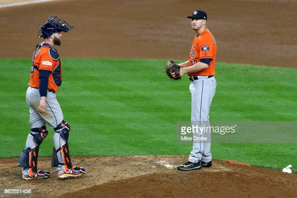 Chris Devenski of the Houston Astros speaks to Brian McCann on the mound during the seventh inning against the New York Yankees in Game Four of the...