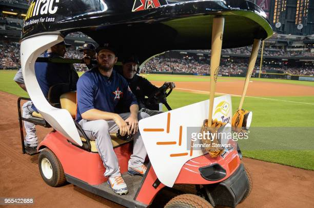 Chris Devenski of the Houston Astros takes a ride to the bullpen in the bullpen cart prior to the MLB game between the Houston Astros and Arizona...