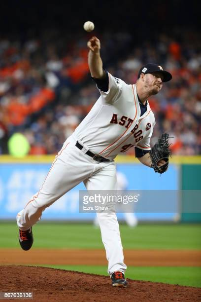 Chris Devenski of the Houston Astros throws a pitch during the eighth inning against the Los Angeles Dodgers in game four of the 2017 World Series at...