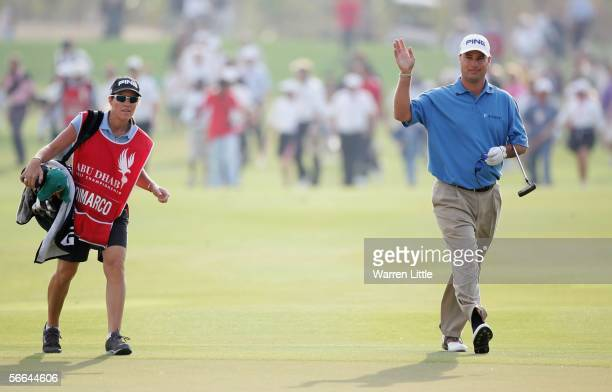 Chris Di Marco of the USA and his wife and caddy Amy walk up the 18th fairway after winning the Abu Dhabi Golf Championship on a score of twenty...