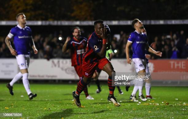 Chris Dickson of Hampton & Richmond Borough celebrates scoring his side's first goal from the penalty spot during the FA Cup First Round match...