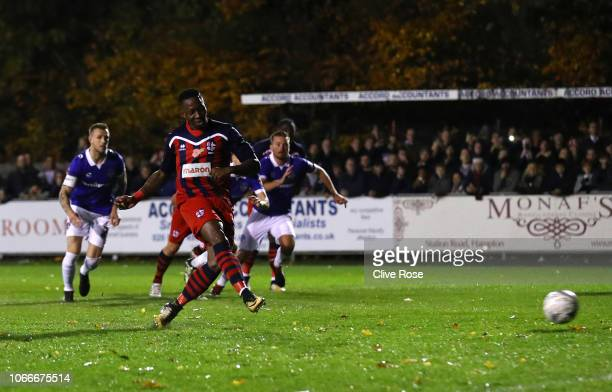 Chris Dickson of Hampton & Richmond Borough scores his side's first goal from the penalty spot during the FA Cup First Round match between Hampton &...
