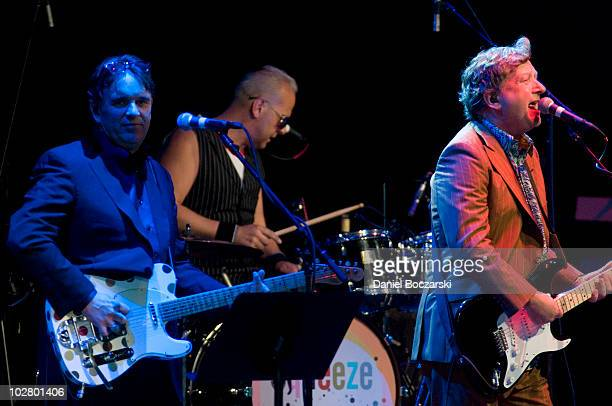 Chris Difford, Simon Hanson, Glenn Tilbrook and John Bentley of Squeeze perform on stage at Ravinia on July 10, 2010 in Highland Park, Illinois.