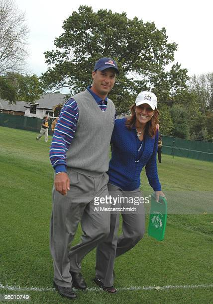 Chris DiMarco and his wife Amy walk the fairway during the afternoon foursome competition at the 2004 Ryder Cup in Detroit Michigan September 17 2004