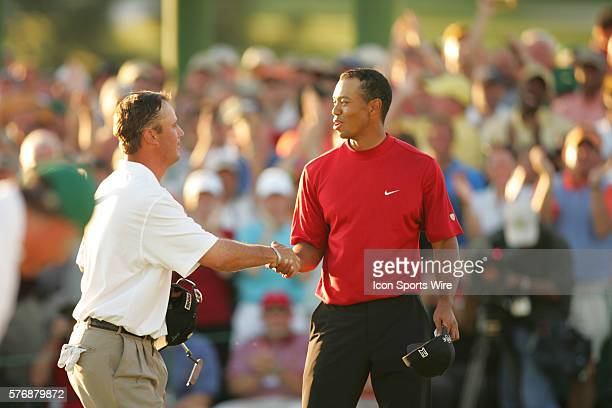 Chris DiMarco left and Tiger Woods shake hands after DiMarco made a putt at No 18 to tie the match and send the tournament into a playoff 2005...