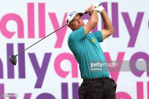 Chris DiMarco of Denver, Colorado hits from the 18th tee during the final round of the The Ally Challenge golf tournament presented by McLaren at...