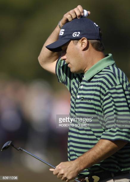Chris DiMarco of the US reacts to his bogey on the 17th hole 10 April 2005 during the 3rd round of the 2005 Masters Golf Tournament at the Augusta...