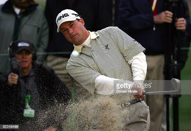 Chris DiMarco of the USA hits out of the bunker on the second hole during the 1st 18 holes of a 36-hole Final Round against David Toms of the USA at...