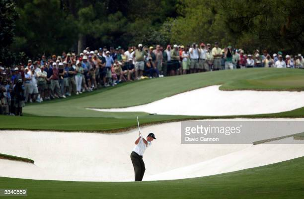 Chris DiMarco of the USA plays his second shot from the bunker on the first hole during the final round of the Masters at the Augusta National Golf...
