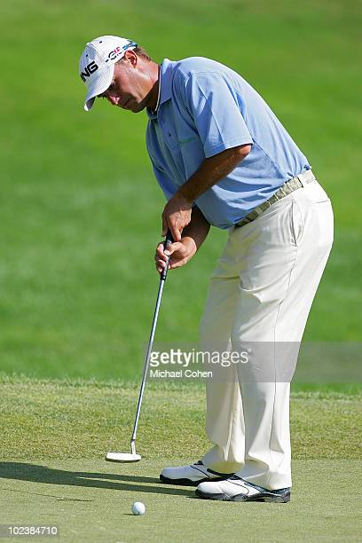 Chris DiMarco strokes a putt using the claw method he developed during the first round of the Travelers Championship held at TPC River Highlands on...