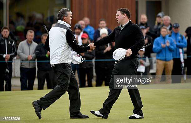 Chris Doak of Scotland is congratulated by Paul Lawrie of Scotland after their match during round 2 of the Saltire Energy Paul Lawrie Matchplay at...