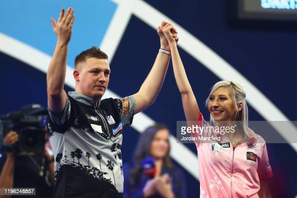Chris Dobey of England acknowledges the crowd with Fallon Sherrock of England after victory in their third round match on Day 12 of the 2020 William...