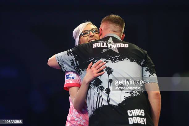 Chris Dobey of England shakes hands with Fallon Sherrock of England after victory in their third round match on Day 12 of the 2020 William Hill World...