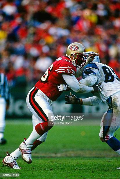 Chris Doleman of the San Francisco 49ers at the line of scrimmage pushes Wesley Walls of the Carolina Panthers during an NFL football game November...