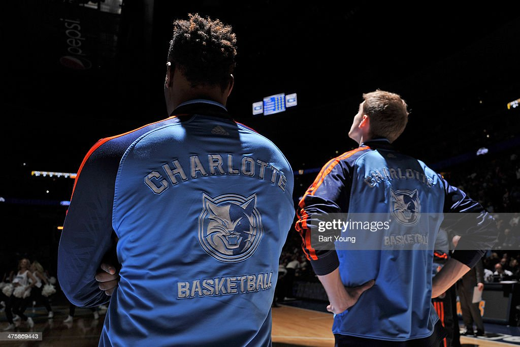 Chris Douglas-Roberts #55 and Cody Zeller #40 of the Charlotte Bobcats stand on the court before the game against the Denver Nuggets on January 29, 2014 at the Pepsi Center in Denver, Colorado.