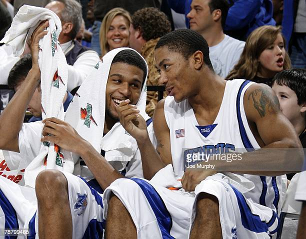 Chris Douglas-Roberts and Derrick Rose of the Memphis Tigers laugh on the bench during a game against the Pepperdine Waves at FedExForum January 5,...