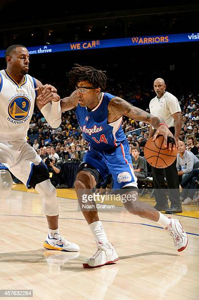 Chris DouglasRoberts of the Los Angeles Clippers drives against Andre Iguodala of the Golden State Warriors on October 21 2014 at Oracle Arena in...