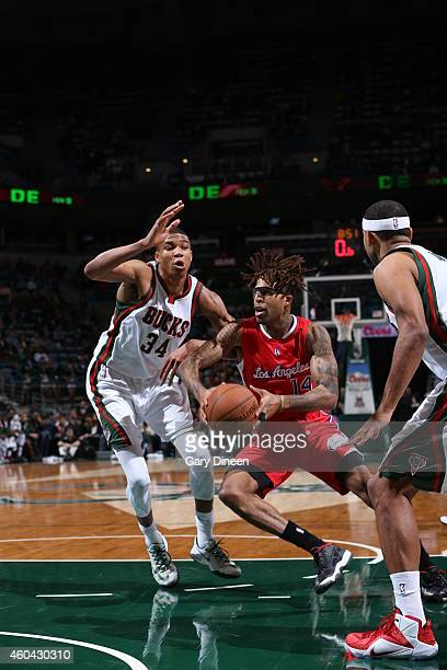 Chris DouglasRoberts of the Los Angeles Clippers drives to the basket against Giannis Antetokounmpo of the Milwaukee Bucks on December 13 2014 at the...
