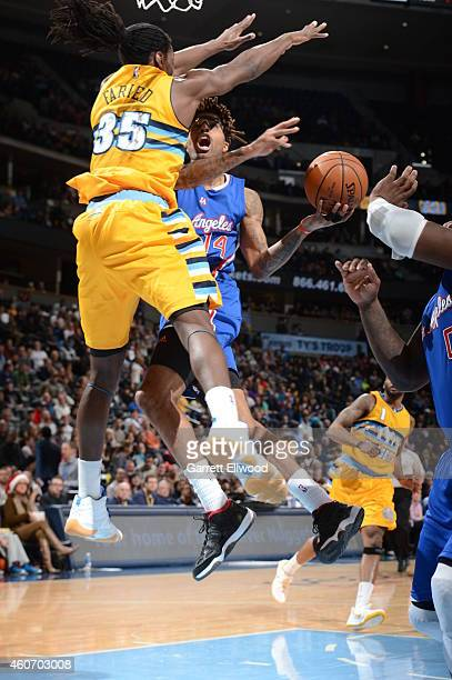 Chris DouglasRoberts of the Los Angeles Clippers goes up for a shot against the Denver Nuggets on December 19 2014 at Pepsi Center in Denver Colorado...