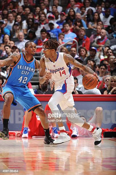 Chris DouglasRoberts of the Los Angeles Clippers handles the ball against Lance Thomas of the Oklahoma City Thunder on October 30 2014 at Staples...