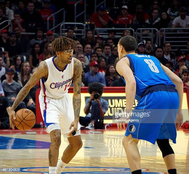 Chris DouglasRoberts of the Los Angeles Clippers in action against Dwight Powell of Mavericks during the NBA game between Dallas Mavericks and Los...