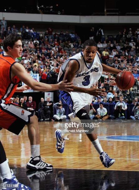 Chris Douglas-Roberts of the Memphis Tigers drives the ball past Darren Mastropaolo of the Bucknell Bison during the Second Round game of the 2006...