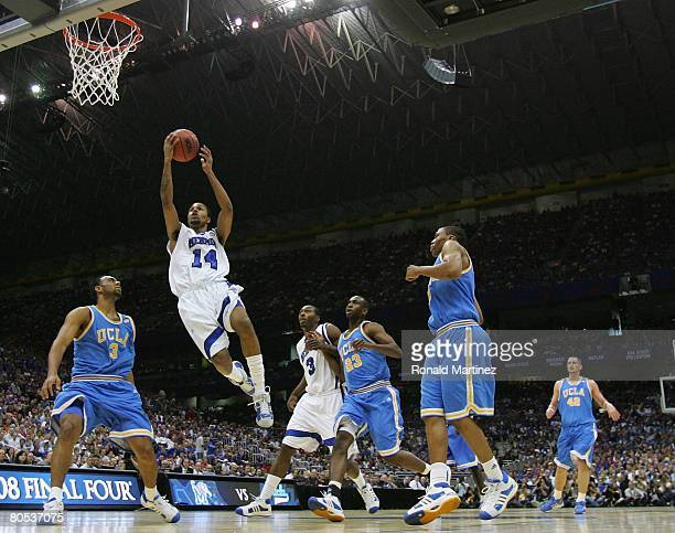 Chris Douglas-Roberts of the Memphis Tigers leaps to the basket against the UCLA Bruins defense in the first half during the National Semifinal game...
