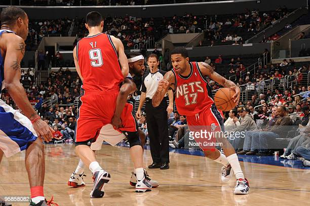 Chris DouglasRoberts of the New Jersey Nets drives against Baron Davis of the Los Angeles Clippers at Staples Center on January 18 2010 in Los...