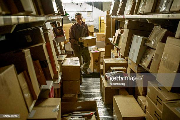 Chris Drain a United Parcel Service Inc driver loads his truck with packages at a UPS sorting facility in San Francisco California US on Thursday Dec...
