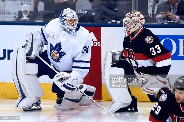 Chris Driedger of the Belleville Senators has a chat with Calvin Pickard of the Toronto Marlies in warmup on November 25 2017 at Air Canada Centre in...
