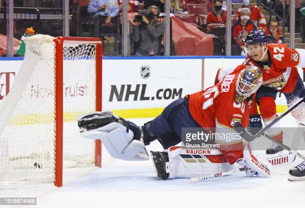 Chris Driedger of the Florida Panthers looks back on a score by Ondrej Palat of the Tampa Bay Lightning in Game Two of the First Round of the 2021...