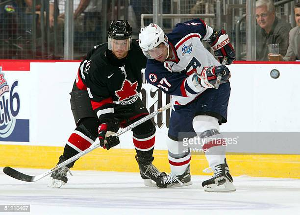 Chris Drury of Team USA and Kirk Maltby of Team Canada watch a loose puck during the first period an exhibition game in the World Cup of Hockey...