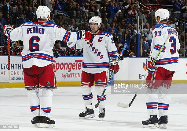 Chris Drury of the New York Rangers celebrates his second period goal with teammates Wade Redden and Michal Rozsival in their game against the New...