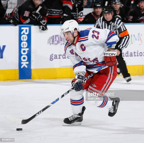 Chris Drury of the New York Rangers moves the puck up ice against the Carolina Hurricanes on December 13 2008 at Madison Square Garden in New York...