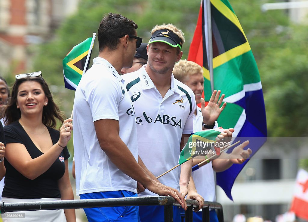 Chris Dry (L) and Phillip Snyman of South Africa watch the fans during a South African street parade ahead of the 2014 Wellington Sevens on February 5, 2014 in Wellington, New Zealand.